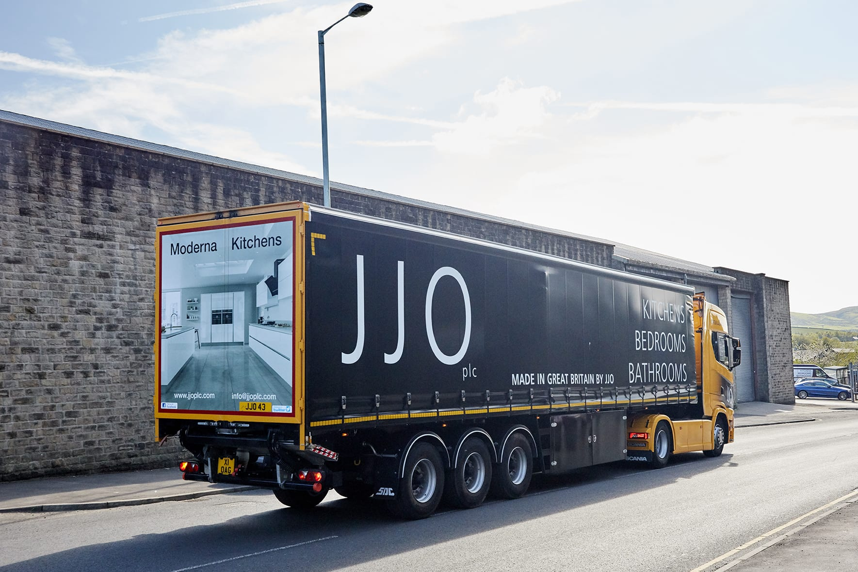 JJO Truck driving away from the factory